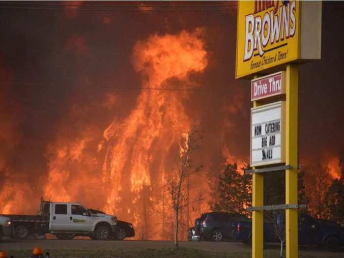 a-wall-of-fire-rages-outside-of-fort-mcmurray-alta-tuesday